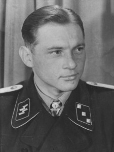 The newly-promoted Wittmann wears his Oakleaves, but is yet to upgrade his rank collar patch to Obersturmführer