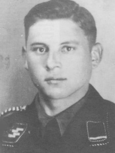 Michael Wittmann in the uniform of the SS-Verfügungstruppe (SS-VT). The earliest known of Wittmann in a black service uniform, it was taken after 9 November 1937. His collar patches indicate the rank of SS-Sturmmann