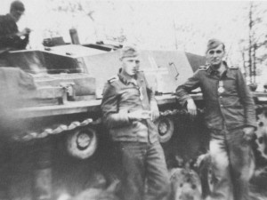 "Wittmann (front, left) and his driver Philipp Fritz stand in front of their StuG III nicknamed ""Buzzard"", following their being awarded the Iron Cross Second Class on 12th July 1941"