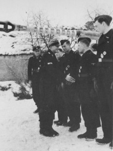 "Knight's Cross winner Michael Wittmann and his crew are congratulated by Joachim ""Jochen"" Peiper.  The"