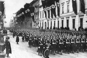 "Men of the Leibstandarte march past Adolf Hitler. They would soon acquire the nickname ""Asphalt Soldiers"""