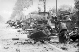 Vehicles of the 1st Rifle Brigade's transport column on the RN 175 outside Villers-Bocage