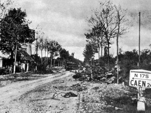 The view back down the RN 175 from the Tilly Junction in June 1944, with wreckage still on the road
