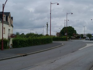 The view back down from Rue Georges Clemenceau to the Tilly Junction, with the Calvary in the foreground